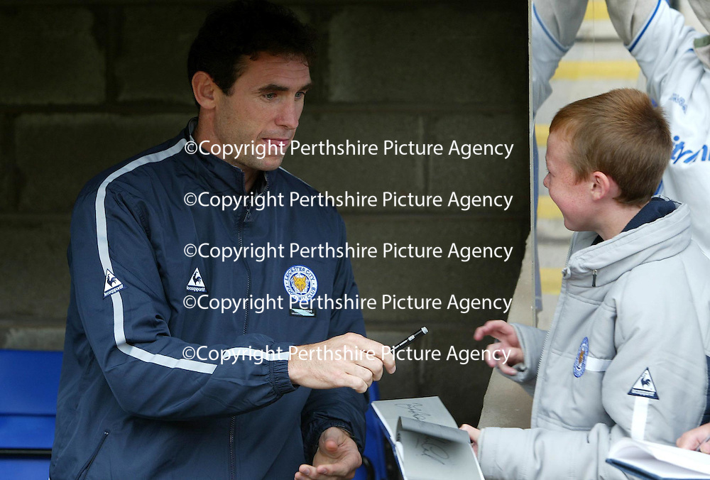 St Johnstone v Leicester City..24.07.04 (Friendly) <br />New signing Martin Keown signs autographs for Leicester fan<br /><br />Picture by Graeme Hart.<br />Copyright Perthshire Picture Agency<br />Tel: 01738 623350  Mobile: 07990 594431
