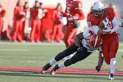 08 November 2014: Christian Bryan (WR)  leans in to try and stop a run by Jamal Towns during an NCAA Missouri Valley Football Conference game between the Youngstown State Penguins and the Illinois State Redbirds at Hancock Stadium in Normal Illinois