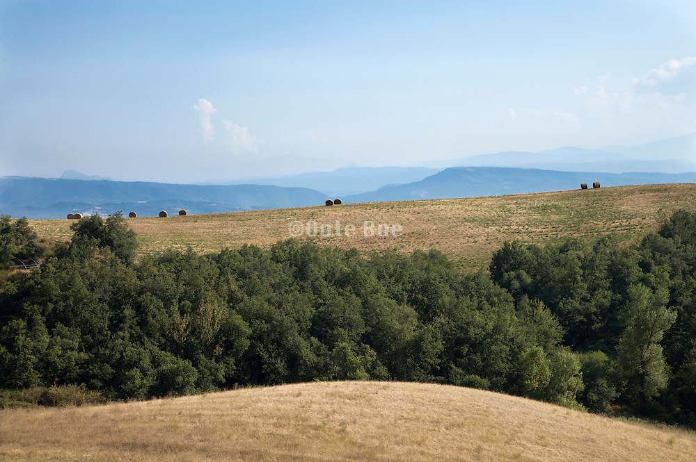 the rolling hills landscape of the Languedoc Aude Razes with mountains in the background