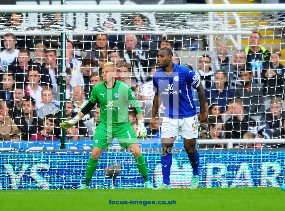 Leicester City goalkeeper Kasper Schmeichel and Wes Morgan of Leicester City (right) during the Barclays Premier League match at St. James's Park, Newcastle<br /> Picture by Greg Kwasnik/Focus Images Ltd +44 7902 021456<br /> 18/10/2014