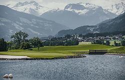 THEMENBILD - der Schwimmteich grenzt direkt an die Sportresidenz Zillertal ****s an. Vom Clubhaus aus hat man einen schönen Blick über den Golfplatz, auf das Dorf Ried und die Berge im hinteren Zillertal. Der 18-Loch-Championshipplatz bietet eine überdachter Drivingrange für PROS und Anfänger. Die Sportsresidenz Zillertal bildet das Herz der Anlage und ist gleichzeitig das beliebte Clubhaus des Golfplatzes, aufgenommen am 06. Juni 2019 in Uderns Oesterreich // the swimming pond borders directly on the Sportresidenz Zillertal ****s. From the clubhouse you have a beautiful view over the golf course, the village of Ried and the mountains in the back of the Zillertal. The 18-hole championship course offers a covered driving range for PROS and beginners. The Sportsresidenz Zillertal forms the heart of the course and is also the popular clubhouse of the golf course, in Uderns, Austria on 2019/06/06. EXPA Pictures © 2019, PhotoCredit: EXPA/Stefanie Oberhauser