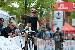A young participant on penny-farting bicycle competes in a Lenape Scorcher vintage bike race, held ahead of the September 11, 2016 Bucks County Classic, in Doylestown, PA.