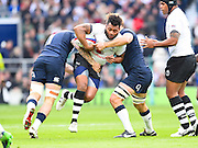 Fijian Benito Masivelu try to break a tackle in the first half during the Autumn International Series match between England and Fiji at Twickenham, Richmond, United Kingdom on 19 November 2016. Photo by Ian  Muir.