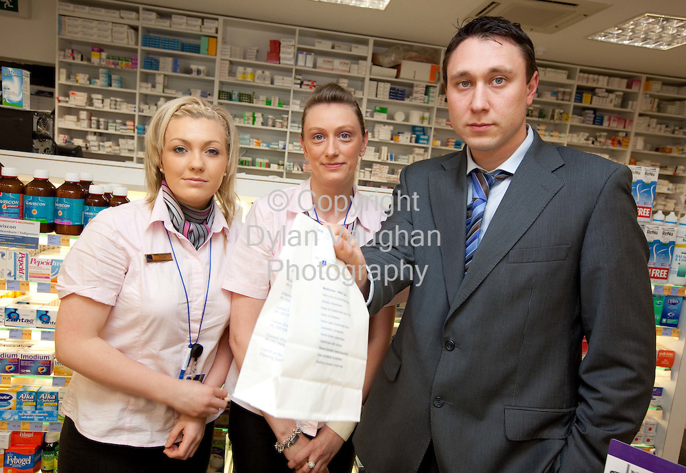 12/8/2009.Donna O Neill, Avril McNamara and Gerry McCauley pictured in McCauleys Chemist in Carrick On Suir County Tipperary yesterday..Picture Dylan Vaughan.