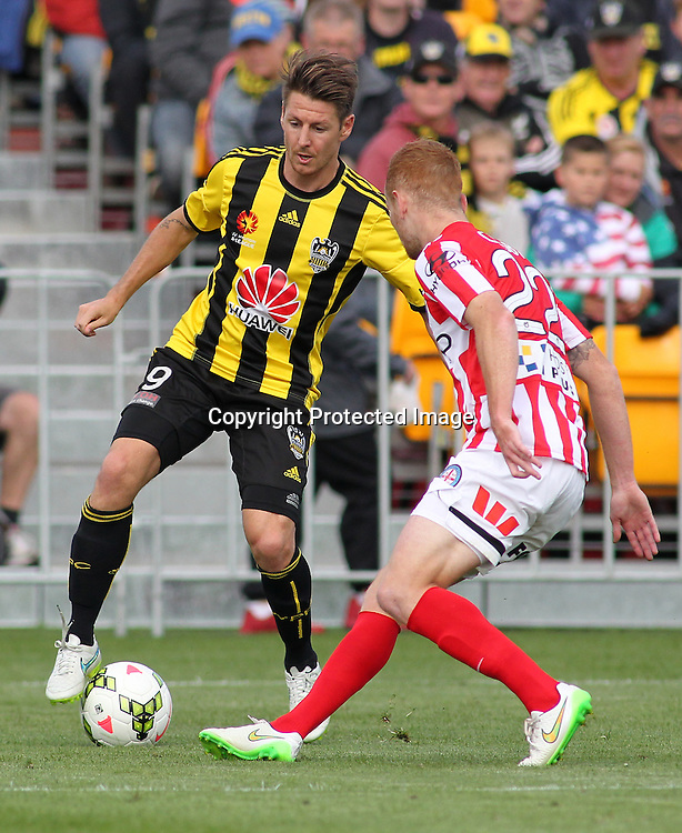 Phoenix' Nathan Burns looks to beat a defender during the A-League football match between the Wellington Phoenix & Melbourne City, at the Hutt Recreational Ground, Wellington, 14 February 2015. Photo.: Grant Down / www.photosport.co.nz