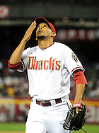 May 19 2011; Phoenix, AZ, USA; Arizona Diamondbacks relief pitcher Esmerling Vasquez (32) reacts after pitching during the eighth inning against the Atlanta Braves at Chase Field. The Diamondbacks defeated the Braves 2-1. Mandatory Credit: Jennifer Stewart-US PRESSWIRE