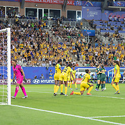 GRENOBLE, FRANCE June 18.  Sam Kerr #20 of Australia is congratulated by team mates after scoring here third goal during the Jamaica V Australia, Group C match at the FIFA Women's World Cup at Stade des Alpes on June 18th 2019 in Grenoble, France. (Photo by Tim Clayton/Corbis via Getty Images)