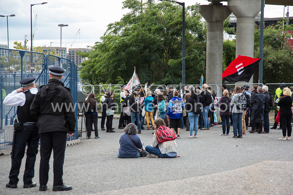 London, UK. 7 September, 2019. Activists block an access road to ExCel London during the sixth day of Stop The Arms Fair protests against DSEI, the world's largest arms fair. The sixth day of protests was billed as a Festival of Resistance and included performances, entertainment for children and workshops as well as activities intended to disrupt deliveries to ExCel London for the arms fair.