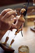 France, Provence, Santonnier M. Roger Jouve painting santon figurine.