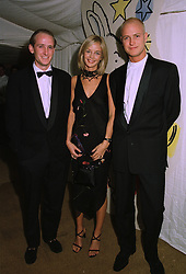 Left to right, the HON. & MRS PIERS PORTMAN and the HON.JUSTIN PORTMAN at a ball in London on 24th September 1997.MBM 23