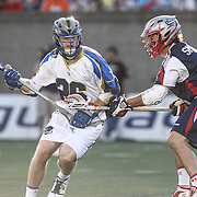 John Haus #26 of the Charlotte Hounds keeps the ball from Matt Smalley #11 of the Boston Cannons during the game at Harvard Stadium on May 17, 2014 in Boston, Massachuttes. (Photo by Elan Kawesch)