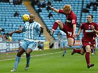 Photo: Ed Godden.<br />Coventry City v Brighton & Hove Albion. Coca Cola Championship. 04/02/2006. <br />Coventry's Dele Adebola (L) is challenged by Paul McShane.