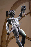 """Larger than life size statue of Perseus showing the head of decapitated (beheaded) Medusa in front of the Loggia dei Lanzi palace in Florence by sculptor Benvenuto Cellini. Search the archive for """"Perseus"""" to see a 'landscape' (horizontal picture) version of this photo."""