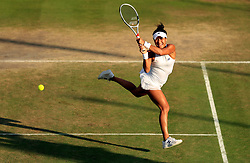 Heather Watson and Henri Kontinen (out of pic) during their mixed doubles match against Ivan Dodig and Sania Mirza on day Nine of the Wimbledon Championships at The All England Lawn Tennis and Croquet Club, Wimbledon.