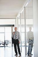 Businessman standing in Corridor portrait.
