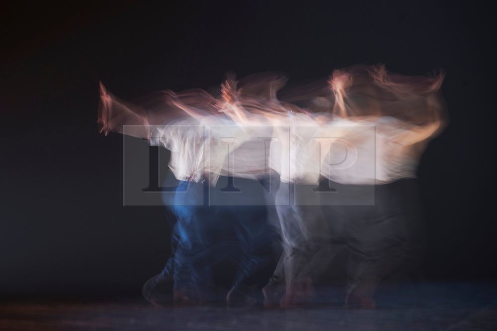 "© Licensed to London News Pictures. 03/07/2013. London, England. Picture: Long exposure motion blur images of Christopher Evans and Jason Jacobs dancing. Hofesh Shechter's ""Political Mother: The Choreographer's Cut"" closes the first ever Sadler's Sampled season, Sadler's Wells Theatre. The entire piece involved 16 dancers and 24 musicians and runs from 3 to 7 July. Photo credit: Bettina Strenske/LNP"