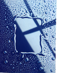 water droplets on shiny smooth blue surface