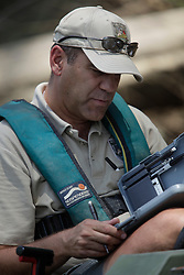 Kentucky Fish and Wildlife Biologist Dave Dreves, Assistant Director of Fisheries, shocks and collects data from a sample of fish in the Cumberland River, Tuesday, July 07, 2009 at Cumberland River in Jamestown.