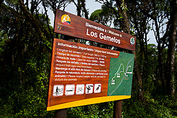"Entrance sign for Los Gemelos / ""The Twins"", a pair of volcanic depressions, Galapagos Islands National Park, Santa Cruz Island, Galapagos, Ecuador"
