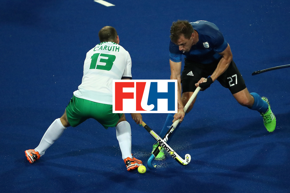 RIO DE JANEIRO, BRAZIL - AUGUST 12:  Peter Caruth #13 of Ireland competes with Lucas Rossi #27 of Argentina during a Men's Preliminary Pool A match on Day 7 of the Rio 2016 Olympic Games at the Olympic Hockey Centre on August 12, 2016 in Rio de Janeiro, Brazil.  (Photo by Sean M. Haffey/Getty Images)
