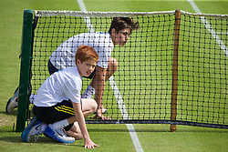 LIVERPOOL, ENGLAND - Thursday, June 18, 2015: Ball boys during Day 1 of the Liverpool Hope University International Tennis Tournament at Liverpool Cricket Club. (Pic by David Rawcliffe/Propaganda)