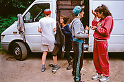 Ravers talking and hangout out by their van, Wales, 2012.