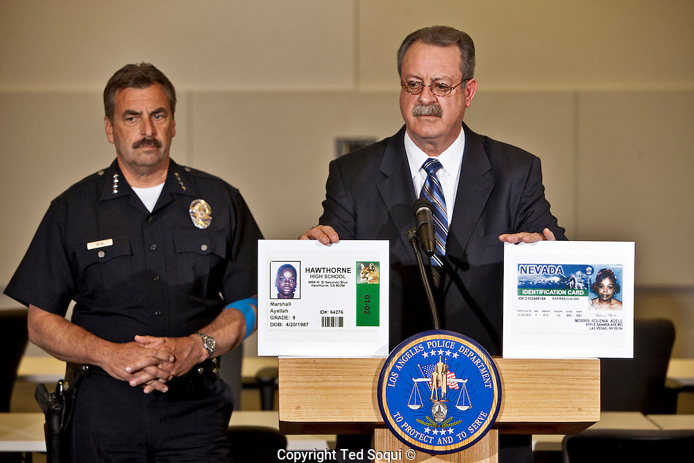 Detective Dennis Kilcoyne and LAPD Chief Charlie Beck.<br /> LAPD Robbery-Homicide detectives hold a press conference to provide new information regarding the &quot;Grim Sleeper&quot; serial murder case. <br /> 8 new photos of potential victims of the &quot;Grim Sleeper&quot; were identified and displayed, along with 55 other images of unidentified missing women.<br /> The LAPD is still asking for the public's help in seeking the identities of the missing women.<br /> The photos were found inside Lonnie Franklin's, the &quot;Grim Sleeper&quot; suspect, home. Franklin remains in police custody, and his trial has not yet started.
