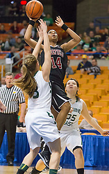Bluefield center Essence Brown (14) shoots under the basket against Wyoming East during a first round game at the Charleston Civic Center.