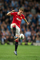 MANCHESTER, ENGLAND - Monday, April 30, 2012: Manchester United's Phil Jones in action against Manchester City during the Premiership match at the City of Manchester Stadium. (Pic by Chris Brunskill/Propaganda)