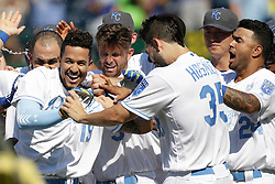 Kansas City Royals Cheslor Cuthbert (19) celebrates his game-winning hit with Eric Hosmer (35) Christian Colon (24) and other teammates in the 13th inning of a baseball game against the Detroit Tigers at Kauffman Stadium in Kansas City, Mo., Sunday, June 19, 2016. The Royals beat the Tigers 2-1. (AP Photo/Colin E. Braley)