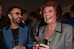 """© under license to London News Pictures. LONDON, 19/05/2011. Beatle Ringo Starr and Cilla Black sharing a joke. Opening of the Tommy Nutter Exhibition """"Rebel on the Row"""" at the Fashion and Textile Museum, London. Photo credit should read BETTINA STRENSKE/LNP"""