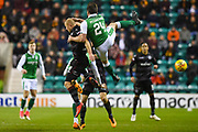 Darren McGregor gets to grips with Curtis Main during the Ladbrokes Scottish Premiership match between Hibernian and Motherwell at Easter Road, Edinburgh, Scotland on 31 January 2018. Picture by Kevin Murray.