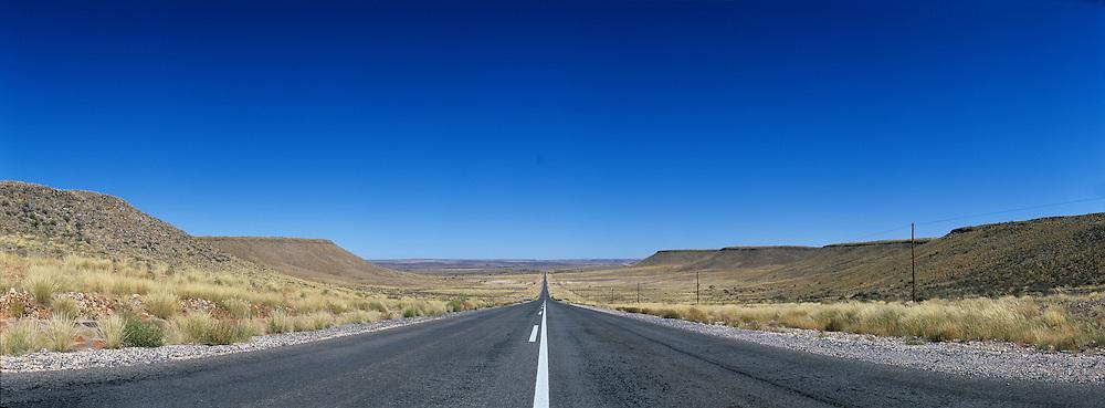 Africa, Namibia, Keetmanshoop, Panoramic view of empty highway through Namib Desert