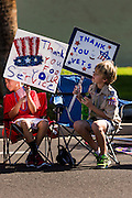 "11 NOVEMBER 2013 - PHOENIX, AZ: Boy Scouts cheer passing veterans at the Phoenix Veterans Day Parade. The Phoenix Veterans Day Parade is one of the largest in the United States. Thousands of people line the 3.5 mile parade route and more than 85 units participate in the parade. The theme of this year's parade is ""saluting America's veterans.""    PHOTO BY JACK KURTZ"