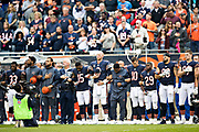 CHICAGO, IL - OCTOBER 22:  Players of the Chicago Bears stand and lock arms during the National Anthem  before a game against the Carolina Panthers at Soldier Field on October 22, 2017 in Chicago, Illinois.  The Bears defeated the Panthers 17-3.  (Photo by Wesley Hitt/Getty Images) *** Local Caption ***