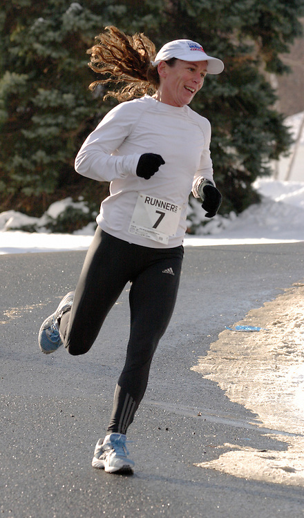 POCATELLO, N.Y. - A female runner nears the finish line compete in the Jingle Jog road race in Pocatello, N.Y., on Dec. 11, 2005.