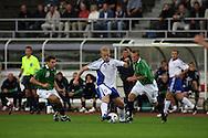 16.08.2006, Olympic Stadium, Helsinki, Finland.<br />Friendly Internatinal Match, Finland v Northern Ireland.<br />Mikael Forssell (Finland) v Aaron Hughes & Sammy Clingan (NIR)<br />©Juha Tamminen<br /><br /><br />..ARK:k