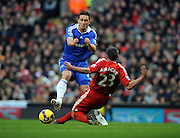 Frank Lampard is tackled by Jamie Carragher during the Barclays Premier League match between Liverpool and Chelsea at Anfield on February 1, 2009 in Liverpool, England.