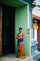 Jaffna, Sri Lanka -- February 8, 2018: A young Hindu caretaker at the Kannakai Amman Temple on Punkudutivu island on the Jaffna Peninsula.