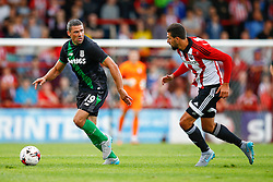 Jonathan Walters of Stoke City under pressure from Yoann Barbet of Brentford - Mandatory by-line: Jason Brown/JMP - Mobile 07966 386802 25/07/2015 - SPORT - FOOTBALL - Brentford, Griffin Park - Brentford v Stoke City - Pre-Season Friendly