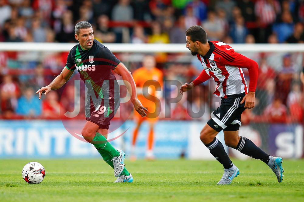 Jonathan Walters of Stoke City under pressure from Yoann Barbet of Brentford - Mandatory by-line: Jason Brown/JMP - Mobile 07966 386802 25/07/2015 - SPORT - FOOTBALL - Brentford, Griffin Park - Brentford v Stoke City - Pre-Season Friendly