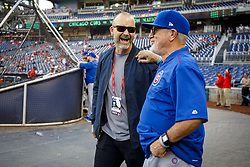 October 7, 2017 - Washington, DC, USA - Former Chicago Cubs catcher David Ross visits with manager Joe Maddon, right, during batting practice before action against the Washington Nationals in Game 2 of the National League Division Series at Nationals Park in Washington, D.C., on Saturday, Oct. 7, 2017. (Credit Image: © Brian Cassella/TNS via ZUMA Wire)