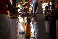 © Licensed to London News Pictures. 24/01/2016 Ipoh, Malaysia. A young devotee carrying a pot of milk waits inside the Kallumalai Murugan Temple in Ipoh, Malaysia, during the Thaipusam Festival, Sunday, Jan. 24, 2016. Photo credit : Sang Tan/LNP