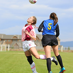 Helena High's Grace Lawlor is fouled by Missoula Big Sky's Megan Sweeny in the first half of Saturday's match at Siebel Fields.