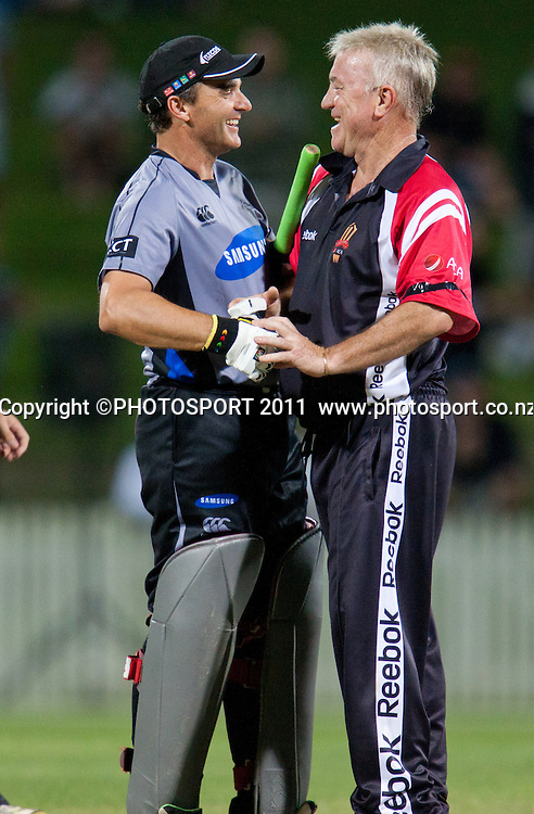 Bryan Young is congratulated by Greg Matthews at the end of the Titans International Twenty20 Cricket, Samsung NZCPA Masters XI v Australia, Seddon Park, Hamilton, New Zealand, Thursday 24 February 2011. Photo: Stephen Barker/PHOTOSPORT