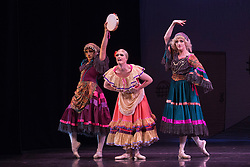 © Licensed to London News Pictures. 18/09/2015. London, UK. Varvara Bractchikova (Giovanni Goffredo) and Eugenia Repelskii (Joshua Thake) as Gypsies with Yakaterina Verbosovich (Chase Johnsey) as Kitri. Les Ballets Trockadero de Monte Carlo (The Trocks) perform the UK premiere of Don Quixote during a photocall at the Peacock Theatre. With Yakaterina Verbosovich (Chase Johnsey) as Kitri, PVyacheslav Legupski (Paolo Cervellera) as Basil, Olga Supphozova (Robert Carter) as Amour, Lariska Dumbcheno (Raffaele Morra) as Mother, Boris Nowitsky (Carlos Renedo) as Count and Varvara Bractchikova (Giovanni Goffredo) and Eugenia Repelskii (Joshua Thake) as Gypsies. Photo credit: Bettina Strenske/LNP