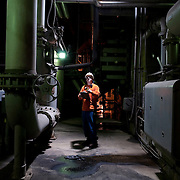 Auxiliary operator Barry Trowbridge on the midnight shift at Merom Station, a coal-fired power plant near Merom, Indiana.