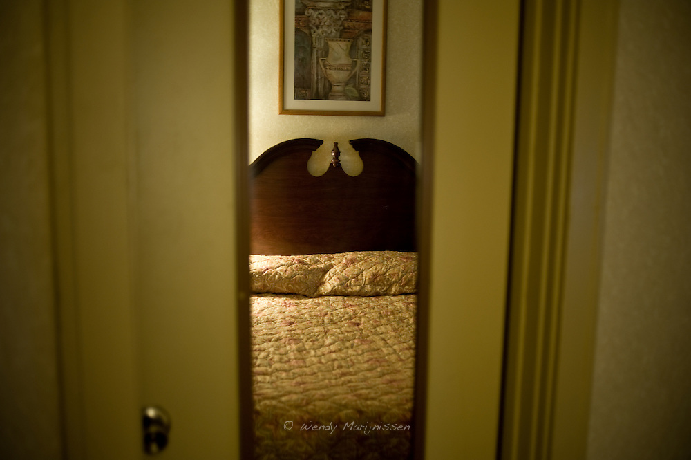 A bedroom in a Dearborn hotel. Detroit, USA, 2011