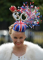 © Licensed to London News Pictures. 21/06/2012. Ascot, UK A woman wears a hat celebrating the Queen's 60th year at Ascot. Ladies Day at Royal Ascot 21st June 2012. Royal Ascot has established itself as a national institution and the centrepiece of the British social calendar as well as being a stage for the best racehorses in the world.. Photo credit : Stephen Simpson/LNP