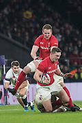 Twickenham, Surrey. UK. George NORTH, taken to ground, with Owen FARRELL'S, low tackle, Wales, Bradly DAVIES and Englands, Richard WIGGLESWORTh, backing up, during the Six Nations Rugby Match, England vs Wales RFU Stadium, Twickenham. Surrey, England. on Saturday 10.02.18<br /> <br /> <br /> [Mandatory Credit Peter SPURRIER/Intersport Images]